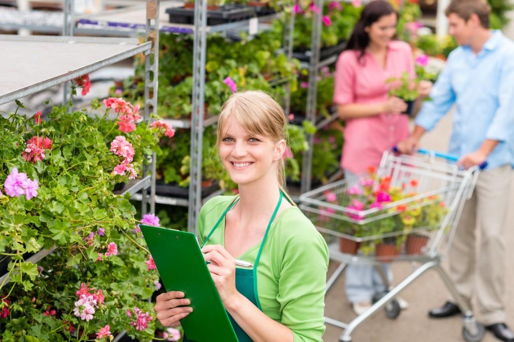 Female florist working at garden centre retail inventory